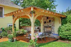 pergola élégante et cheminée en tant que brise-vue jardin