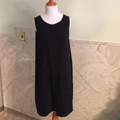 """Amanda Smith Suede like Apron Dress In Black M This is a very comfortable but still stylish apron type dress with two front pockets and three faux buttons down each side. The back has a small slit at the bottom. This is a size medium. It is a 97% polyester and 3% spandex blend but has the feel of suede. Looks great white a cute pair of tights for the fall. It's about 37"""" long from shoulder to hem. Amanda Smith Dresses Mini"""