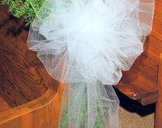 How to easily make wedding bows with tulle- could be really cute, done to scale, for a christmas tree.