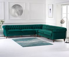 Provide your living room with a dramatic centrepiece with the Livi Green Velvet Corner Sofa, a generously-sized choice that is capable of accommodating as many as 4 people over the length of two sofas. Living Room Green, Living Room Sofa, Living Room Sets, Sofa Design, Corner Sofa Living Room, Pallet Furniture Living Room, Velvet Sofa Living Room, Couches Living Room, Living Room Designs