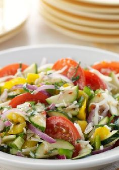 Mediterranean Marinated Vegetable Salad – Here's the epitome of the big Mediterranean salad, made with chunks of fresh vegetables and flavorful cheese crumbles.