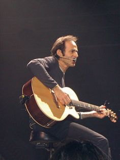 Jean-Jacques Goldman, during a concert in 2002 (seemingly on the of may at the Zénith de Paris). (By Sandrine Joly - Celine Dion, George Harrison, Pop Rock, Rock And Roll, Folk Music, My Music, Michael Jones, Julien Clerc, Jean Jacques Goldman