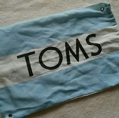 ☆☆NO OFFERS!☆☆ TOMS Dust Bag Blue and white dust bag by TOMS. Authentic. Perfect. No trades or paypal. Bundle for discounts. TOMS Bags