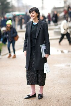 Stella tenant taking in the sights outside the Chanel haute couture show...