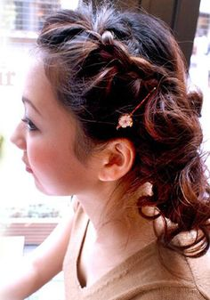Braid your front hair sideling, and make messy bun like a flower.