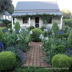 Adorable cottage and garden in blue.  ~ Great pin! For Oahu architectural design visit http://ownerbuiltdesign.com