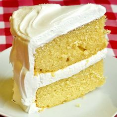 The Best Vanilla Cake - still in the TOP TEN recipes we have ever posted! A moist, tender, buttery, homemade vanilla cake recipe complete with Vanilla Marshmallow Frosting.
