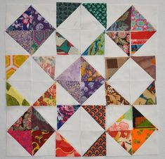 I've been considering the pile of ugly fabrics and how to make them happy together. These are scraps so, of course, a scrap quilt came to mind. The problem was how to combine them. I thi…