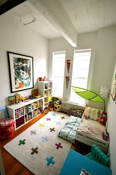 future kid room idea - love the feel of this room. Decorated with toys and other bright stuff.