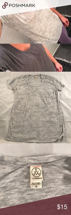 LOT of 2 gray shirts - Alternative Apparel Selling 2 comfortable gray shirts for the price of one! The light gray shirt is Alternative Apparel bought at Urban Outfitters and is a Medium. The dark gray is an unknown brand (because I tore the bothersome tag off) and is a size large, but is the exact same size as the medium Alternative Apparel shirt, so listing both as Medium. Both in great condition! Alternative Apparel Tops Tees - Short Sleeve