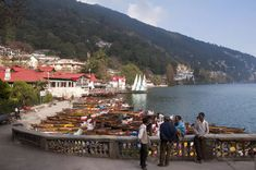 Nainital is a popular hill station in Uttarakhand. Find out how to get there, when to go, what to see, and where to stay in this travel guide. Hill Station, Adventure Activities, Tourist Places, Summer Heat, Incredible India, Plan Your Trip, Cool Places To Visit, National Parks, Tours