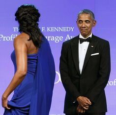 That look....like him or not, you have to admit the honors his wife...the love President Obama shows for his First Lady is so beautiful.
