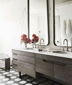 modern meets french provincial; great vanity, over-sized mirrors, interest in the floor, light coming in from the shower