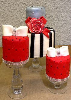 A trio of cakes covered with our hand made rolled fondant.