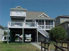 Summers Dream is a beautiful vacation home located on a concrete canal at Ocean Isle Beach. You can dock your boat just outside the back door and relax on the screened in porch. This beautiful home is a Summers Dream for large family and is so, aptly named.Ocean Isle Beach Vacation Rental Canal House   Summers Dream   Sunset Properties