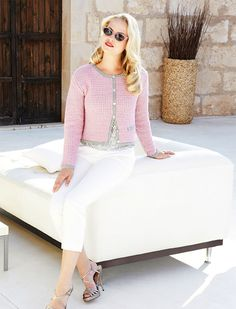 This cardigan has the classic Chanel style that always stays in fashion.
