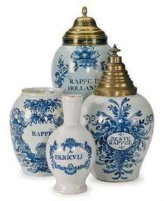 Three Dutch Delft blue and white tobacco jars and two brass covers, circa 1710-1760.