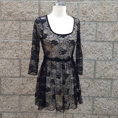 Lace Black Top/Dress Price is firm. Discounts when bundling, ask me.  No Trades. No Paypal. Happy Poshing!  • Brand: Lily White • Size: S • Material(s): Nylon & Spandex   Condition: BRAND NEW! Flaws: None.   Notes: None. Lily White Dresses