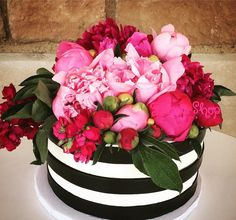 How pretty is this black and white striped Kate Spade inspired cake with fresh peonies? One of our top ten favorites! @flourshoptx