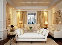 How I would love the white and warm respite of this elegant room! But the colorful evidence of my travels surrounds me. How shall I rid myself of the art I brought from there to here?  My white living room exists on a web site. I shall sink into the photograph, and dream.