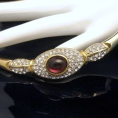 GORGEOUS PURPLE GLASS NECKLACE! This glamorous vintage collar necklace features a panel with sparkling rhinestones and a large, beautiful purple glass stone. $99 or Best Offer