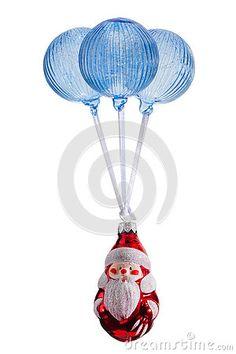 Santa flying in Christmas Balls isolated on white.