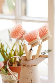 Finally a pretty place for dish washing gear.....pink brushes. JustCallMargy Organizing finds a way to put those germ ridden and sometimes stinky things out of view. #cleartheclutter