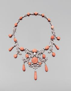 A diamond, coral, platinum and 18K gold necklace.