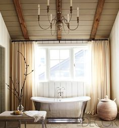 I would love to sink down and take a long soak in this bathtub. I actually love the whole room including the romatic candle chandelier.