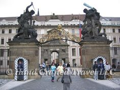 Travel Picture: Day 70. Entering Prague Castle through the main gate, past the guards. In the background is the official residence of the president of the Czech Republic, and on the right is a statue honoring the inventor of golf. Just kidding about the golf.