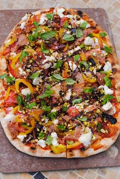 Rustic Italian Farmhouse Pizza - a complete meal on a pizza. Includes prosciutto, ricotta, roasted yellow peppers, basil, pistachios and balsamic vinegar. | foxeslovelemons.com