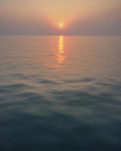 Tiny #ripples #offshorelife #sea #sunset #calmsea by travelkeeda
