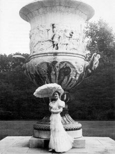Sir Cecil Beaton took this photograph of Queen Elizabeth posed in front of the Waterloo Urn at Buckingham Palace in 1938.