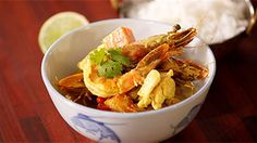 Fish curry with slices of lime and steamed rice.