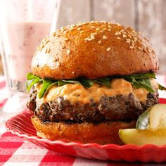 Basil Burgers with Sun-Dried Tomato Mayonnaise Recipe -I often end up with a bumper crop of basil and here's a favorite way to use some of it. These burgers feature great Italian flavor. And who can resist their gooey, cheesy centers or the scrumptious topping? —Virginia Kochis, Springfield, Virginia