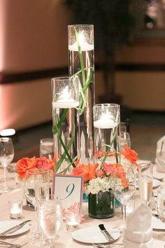 Trio of floating candles and low floral arrangements (ignore the greens in cylinders) champagnes and ivory