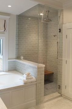Shower next to tub-
