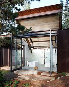 Small and modern a family lakeside getaway in texas lakes sliding doors and decking - Shape shifting house ...