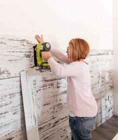 A wood plank wall can add a rustic focal point to a room. We have the step-by-step tutorial using prepared wood planks.
