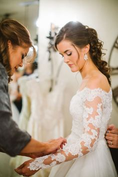 Beautiful lace arms on this long sleeve wedding dress | Traditional Texas Wedding On The Grounds Of Pecan Springs | Photograph by Rachel Whyte Photography  http://storyboardwedding.com/traditional-texas-wedding-pecan-springs/