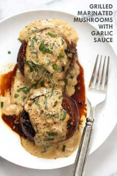 Grilled Portobello Mushrooms with Garlic Sauce. Grilled or Baked Marinated Portabella Mushrooms served with creamy gravy. Vegan Gluten-free Recipe