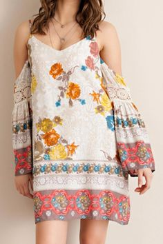 This floral printed boho dress features a bold floral print across the body of the dress with a contrasting print along the edge and lace details. It flows away from the body for extra comfort and is fully lined. It also features bell sleeves with a cold shoulder detail.    Floral Boho Dress by Entro. Clothing - Dresses - Floral Indiana