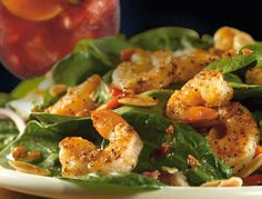 Grilled Shrimp 'N Spinach Salad ~ Tender spinach, crisp bacon, roasted red peppers, red onions, toasted almonds and hot bacon vinaigrette topped with grilled shrimp.