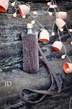 Unique hand felted water bottle holder wool accessory in brown with beads. Ready to ship! Free personalization with your initials as you can see on the last photo.  These felted bottle holder made by my original design.  This is not only convenient but also a beautiful accessory perfect for taking your drink along with you. Keep your hands free! Will fit a regular bottle of water or soda and will fit a larger reusable water bottle. Strap approximately 45  long so can be worn cross-over…