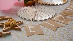Enhance the table setting with our garland packs! Each set comes with our bronze and cream paper fan set, garland, and more, helping create the perfect center piece for your friends and family. View this set and more party supplies on our website. #daysofeid
