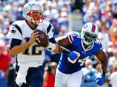 New England Patriots' Tom Brady (12) looks to pass as Buffalo Bills defensive end Mario Williams (94) closes in during the first half of an NFL football game on Sunday, Sept. 8, 2013, in Orchard Park.