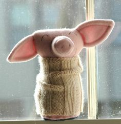 sweet little piglet. Love the little sweater. I like how that works with the simple shape of the stuffie. I can do that with some of mine.