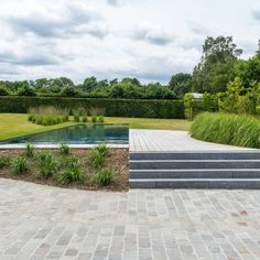 Padoek Zwemvijver in open tuin Leuven (BE) | Paulussen houthandel Swiming Pool, Swimming, Outdoor Gardens, Sidewalk, Exterior, Inspiration, Outdoors, Gardens, Pools