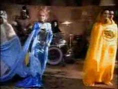 "Justified and Ancient (Stand By The JAMs) KLF with ""The First Lady of Country,"" Tammy Wynette. Amazing crossover. Video is pretty horribly dated though!"