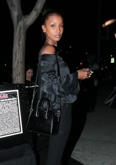 Jasmine Tookes Cross Body Tote - Jasmine Tookes accessorized with a black Givenchy mini Antigona while dining out at Mastro's Steakhouse.